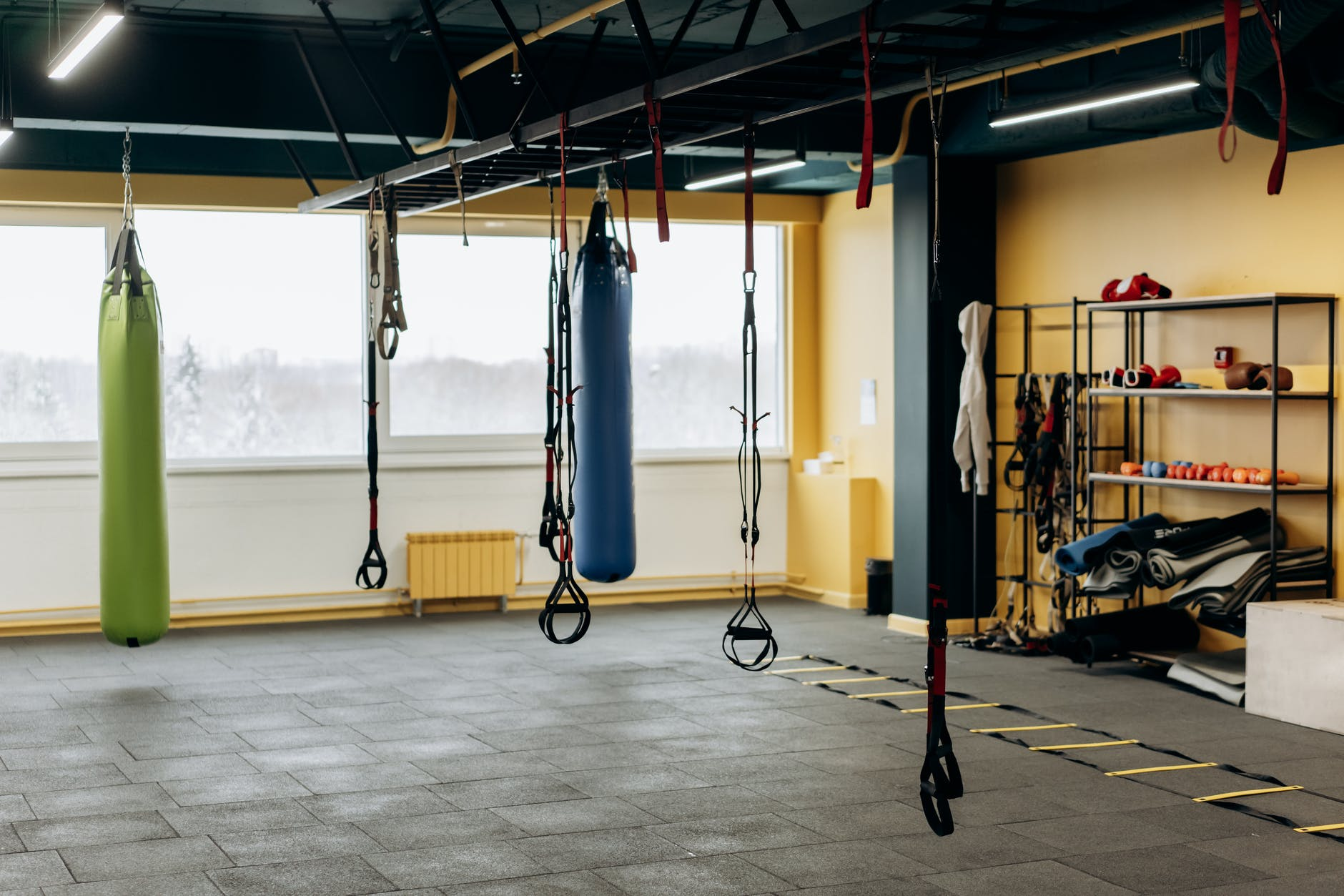 a spacious gym with tools and equipments