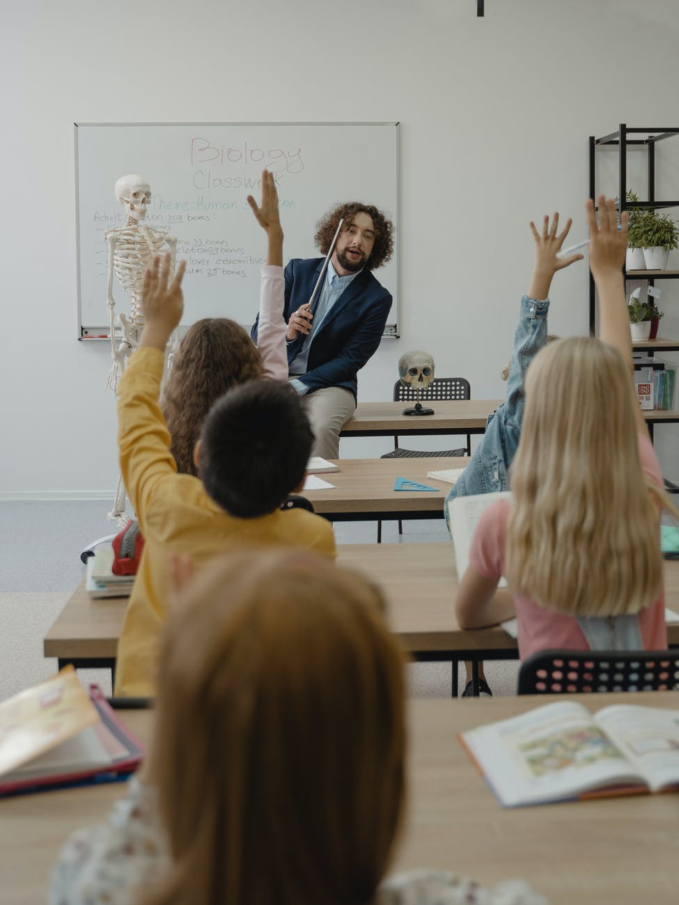 children inside a room participating in class