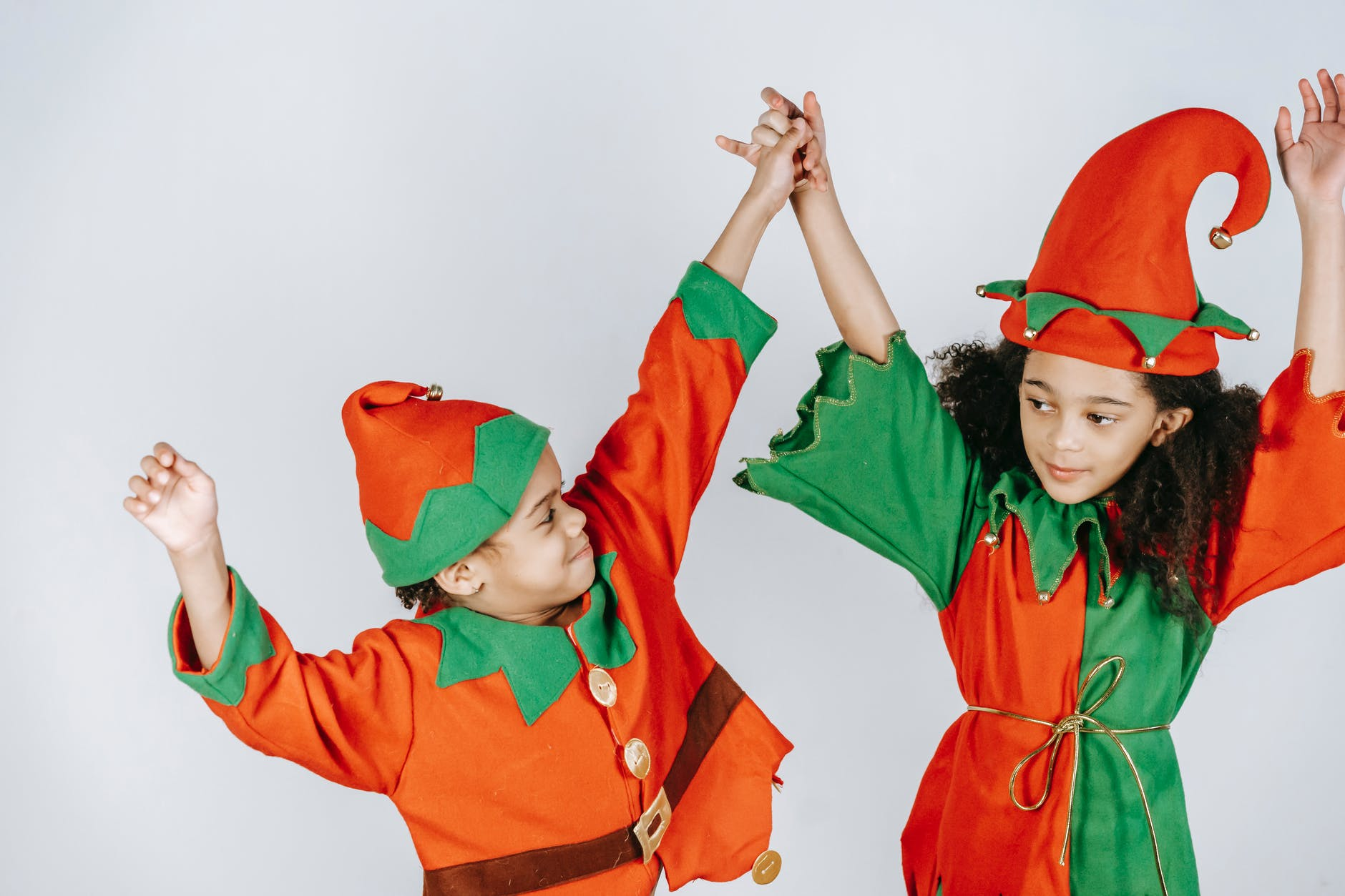 cute black children in elf outfits on white background