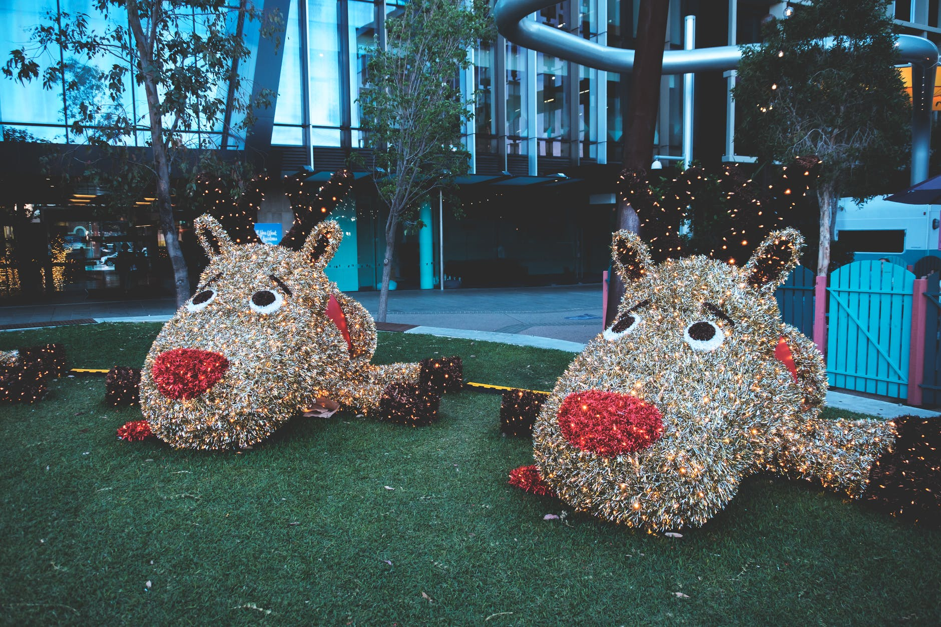 giant funny figures of animals placed on green lawn