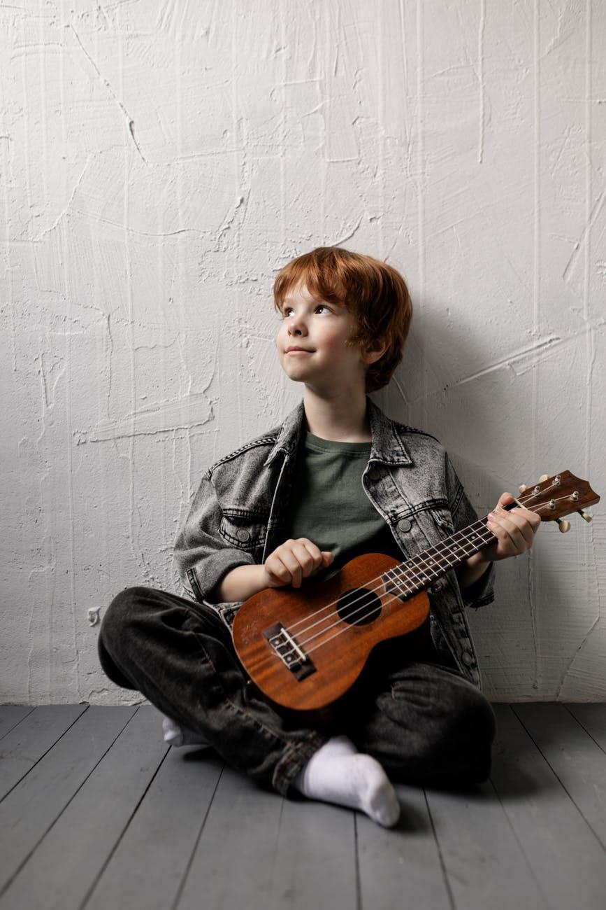 boy holding a ukulele