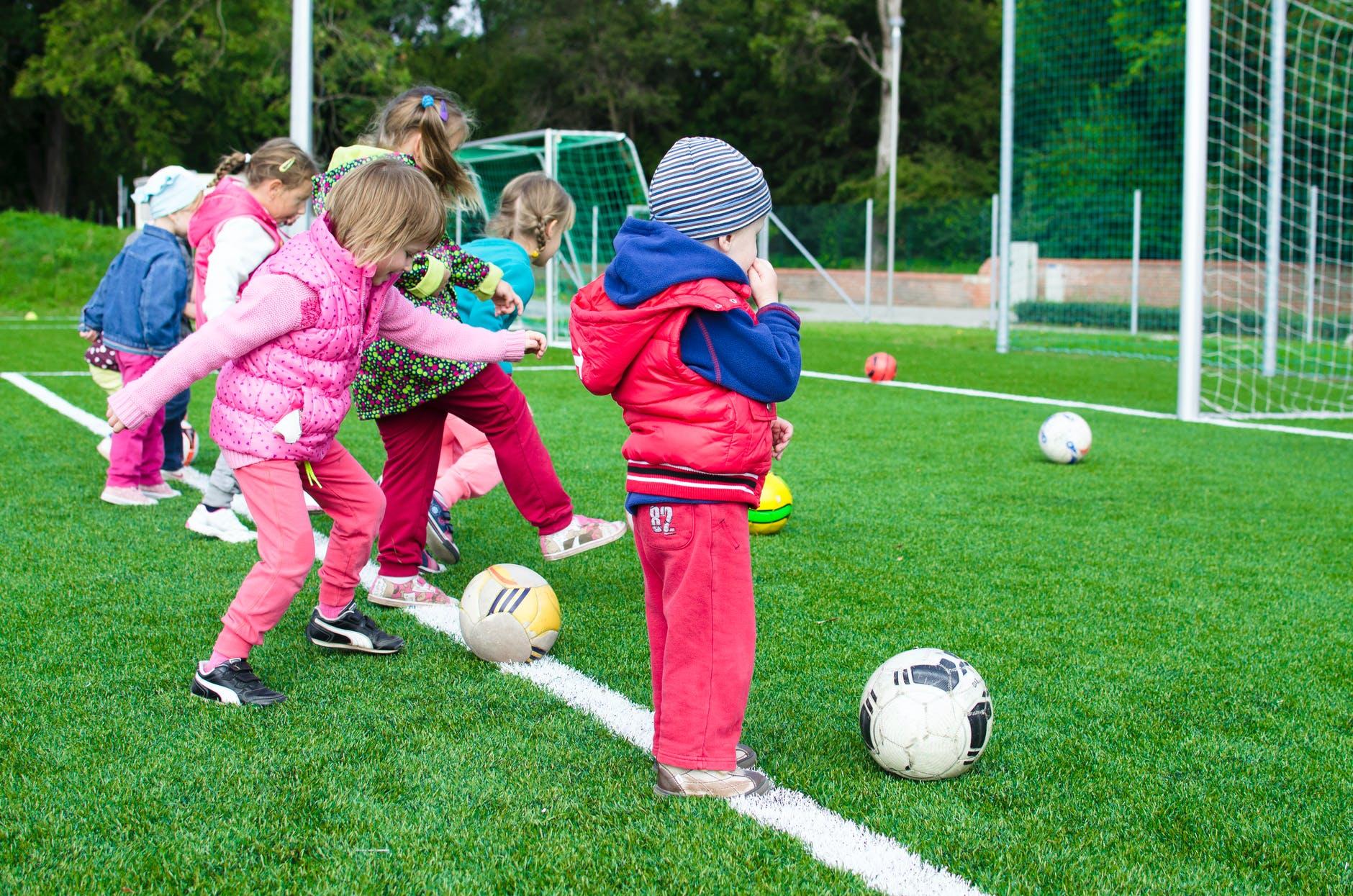 toddler playing soccer